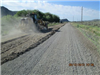 Tractor Spreading Material Onto the Road